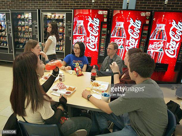 Students eat lunch before a bank of vending machines at Jones College Prep High School April 20 2004 in Chicago Illinois The Chicago Public School...