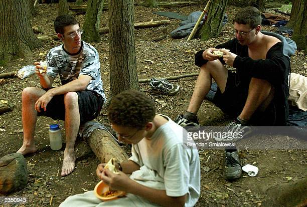 Students eat while camping out at the Center for Attention and Related Disorders camp at the Great Hollow Wilderness School July 30 2003 in New...