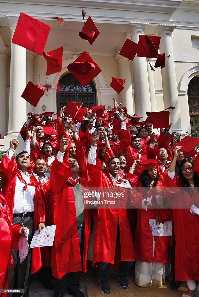 Students enjoy after collecting their degrees during the 91th annual convocation of Delhi University at Old Vice-Regal Lodge on March 14, 2014 in New Delhi, India. Lt Governor Najeeb Jung was the chief guest.