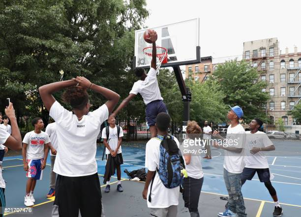 Students enjoy the newly refurbished courts during the KD Build It and They Will Ball court ceremony on July 24 2017 in New York City