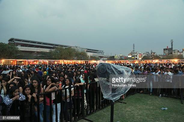 Students enjoy the performance of Bollywood singer Sunidhi Chauhan during a Nexus Sri Venkateswara College Annual Fest 2016 on March 5 2016 in New...
