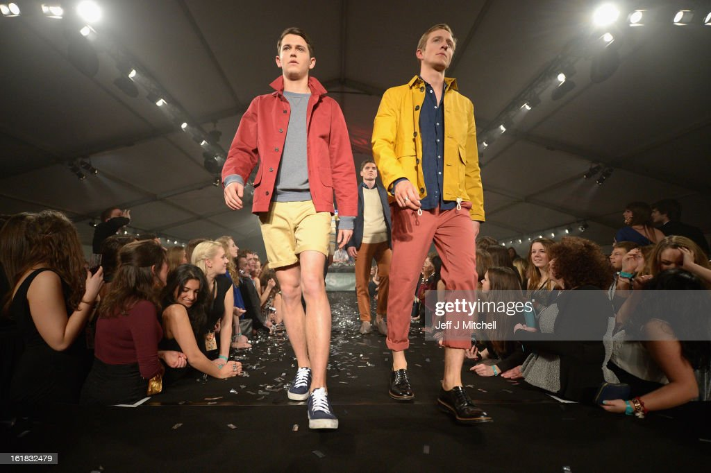 Students enjoy themselves during the UK's largest student run fashion show held at the University of St Andrews on February 16, 2013 in St Andrews, Scotland.Over 1,500 people attended the fashion show held in a purpose built marquee on the Lower College Lawn at University of St Andrews. The student run fashion show will guide this year's effort to raise significant funds for the University of St Andrews 600th Anniversary campaign. Fundraising from a fashion show in St Andrews and London will benefit the Wardlaw Scholarship scheme, which provides financial assistance for academically gifted students who would otherwise struggle with the cost of studying at the University of St Andrews.