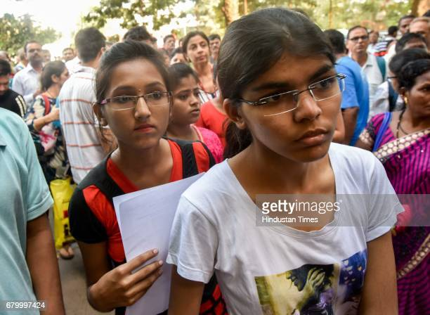 Students enter examination centre to appear for National EligibilityCumEntrance Test medical entrance exam on May 7 2017 in Mumbai India The National...