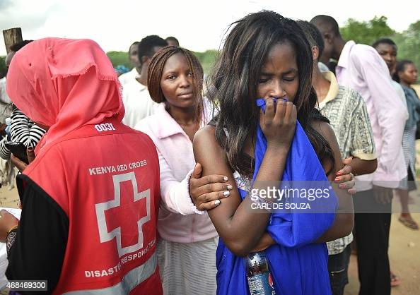 Students evacuated from Moi University during a terrorist seige react as they gather together in Garissa on April 3 2015 before being transported to...