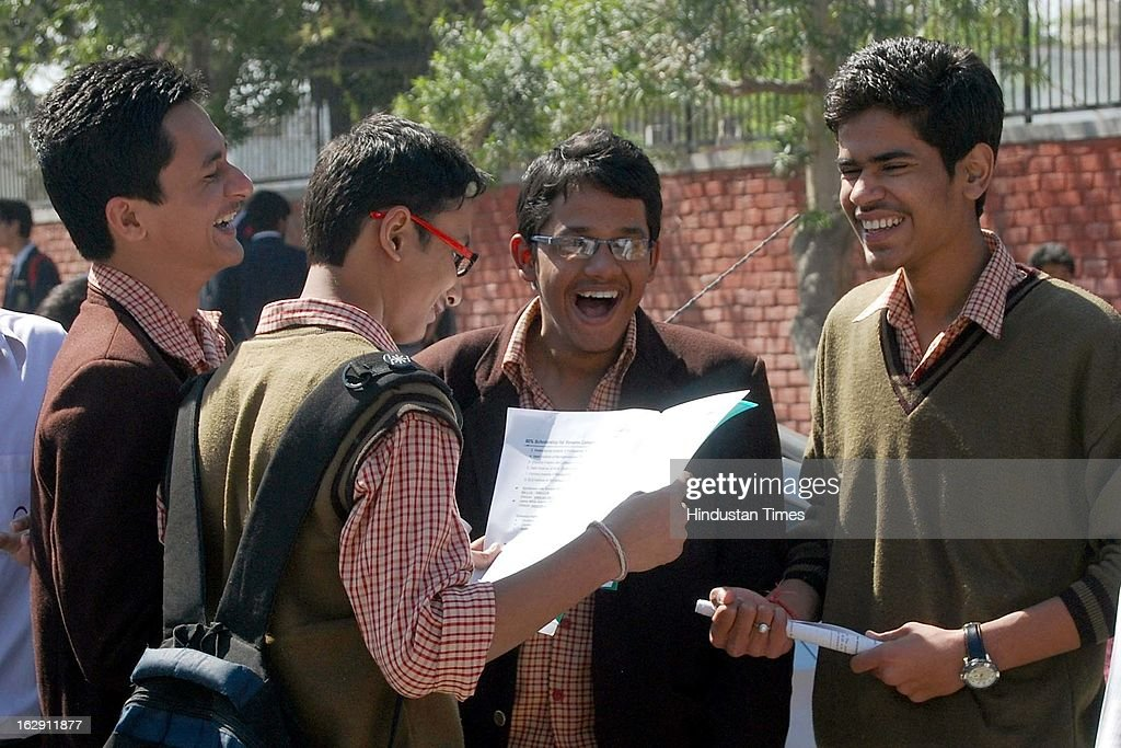 Students evaluating their question paper after giving their Central Board of Secondary Education (CBSE) Board Examinations on March 1, 2013 in Noida, India. Over all 22 lakh students are appearing for their exam for Class X and XII this year.