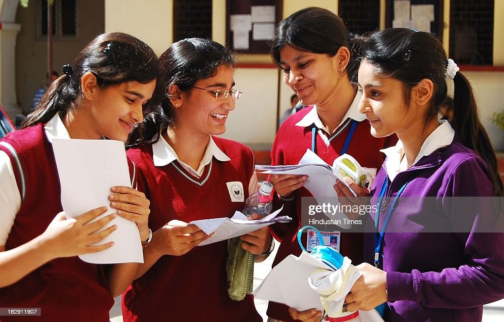 Students evaluating their question paper after giving their Central Board of Secondary Education (CBSE) Board Examinations on March 1, 2013 in Allahabad, India. Over all 22 lakh students are appearing for their exam for Class X and XII this year.