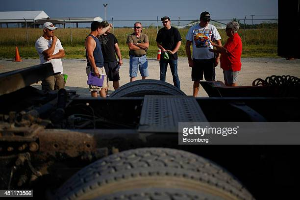 Students examine a tractor trailer during a commercial drivers license class at Lake Cumberland CDL Training School in Mt Sterling Kentucky US on...