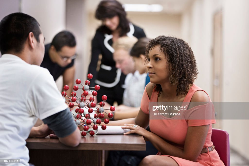 Students examining molecular model : Stock Photo