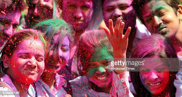 Students exchanging dry colours with each other before the Holi festival at Women's College campus on March 19 2016 in Ranchi India Holi is a...