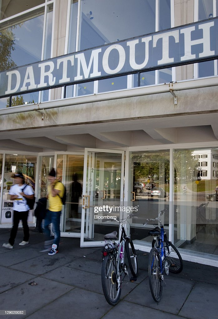 Students exit a building on the Dartmouth College campus the day before a Republican presidential debate sponsored by Bloomberg via Getty Images and...