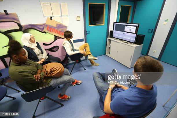 Students Fatima Zahra Matthias Indrit and Evelise pose during the preparation of a film in the highschool Carnot on the French riviera city of Cannes...