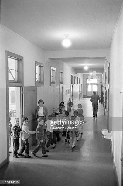 Students file out of their classrooms and in the hallway of their school during a atomic bomb drill 1960s