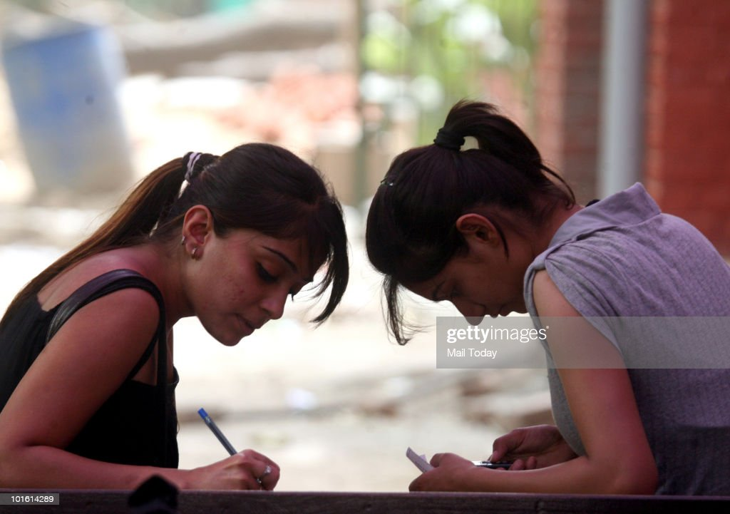 Students fill in the admission forms at Hindu College at North campus in New Delhi on June 3, 2010.