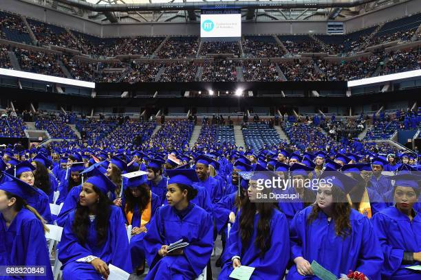 Students fill the stadium during The Fashion Institute of Technology's 2017 Commencement Ceremony at Arthur Ashe Stadium on May 25 2017 in New York...