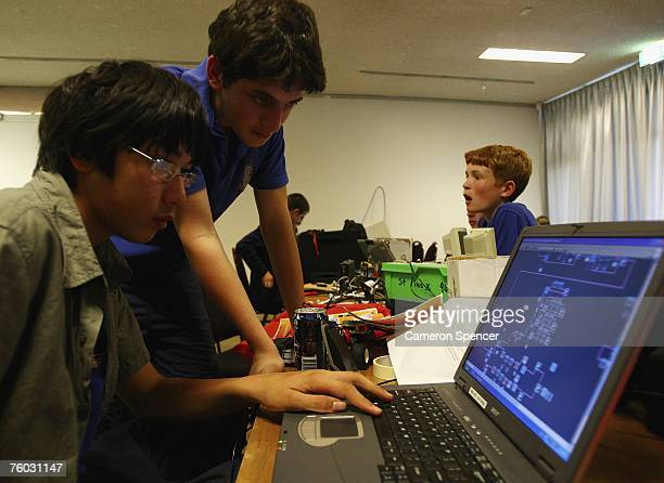 Students fine tune their robots via laptop computer during the 2007 NSW State Competition of RoboCup Junior Australia at the Roundhouse University of...