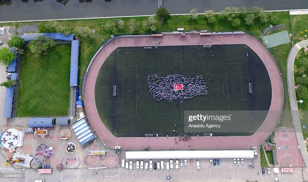 2.000 students form Turkey map, with the Turkish flag in the middle, which is weaved by 1.299 student as a 'largest hand woven Turkish flag', during a choreography within the 'Thousand Tiny Hand One Foot' project in Kagithane district of Istanbul, Turkey on April 29, 2016.