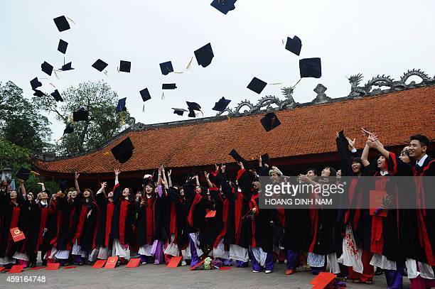 Students from a local college celebrate their graduation at the Temple of Literature in Hanoi on November 18 2014 The temple is where Vietnam's...