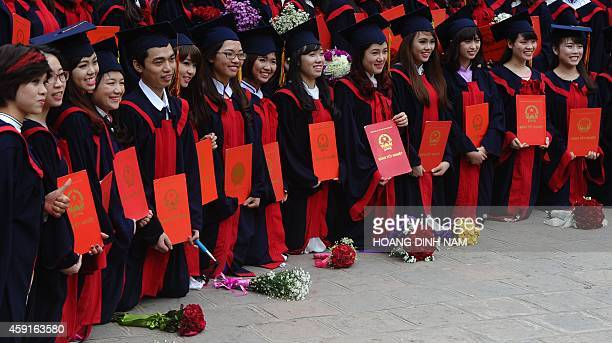 Students from a local college pose as they attend a graduation ceremony at the Temple of Literature in Hanoi on November 18 2014 The temple is where...
