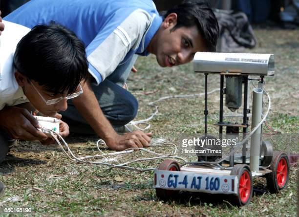 Students from Ahamdabad showcasing the skill of their robot during the Agro robot competition at TECHFEST IIT Powai