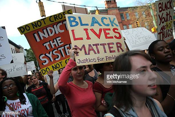 Students from Baltimore colleges and high schools march in protest chanting 'Justice for Freddie Gray' on their way to City Hall April 29 2015 in...
