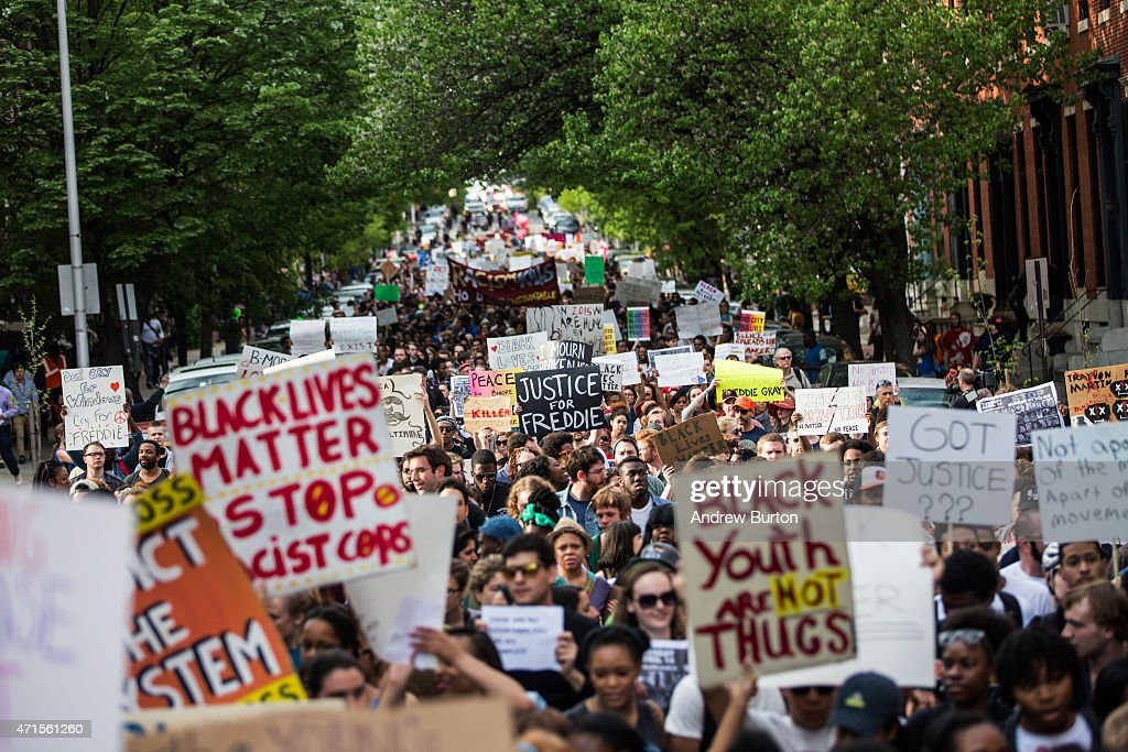 Students from Baltimore colleges and high schools march in protest chanting 'Justice for Freddie Gray' on April 29, 2015 in Baltimore, Maryland. Baltimore remains on edge in the wake of the death of Freddie Gray, though the city has been largely peaceful following a day of rioting this past Monday. Gray, 25, was arrested for possessing a switch blade knife April 12 outside the Gilmor Houses housing project on Baltimore's west side. According to his attorney, Gray died a week later in the hospital from a severe spinal cord injury he received while in police custody.