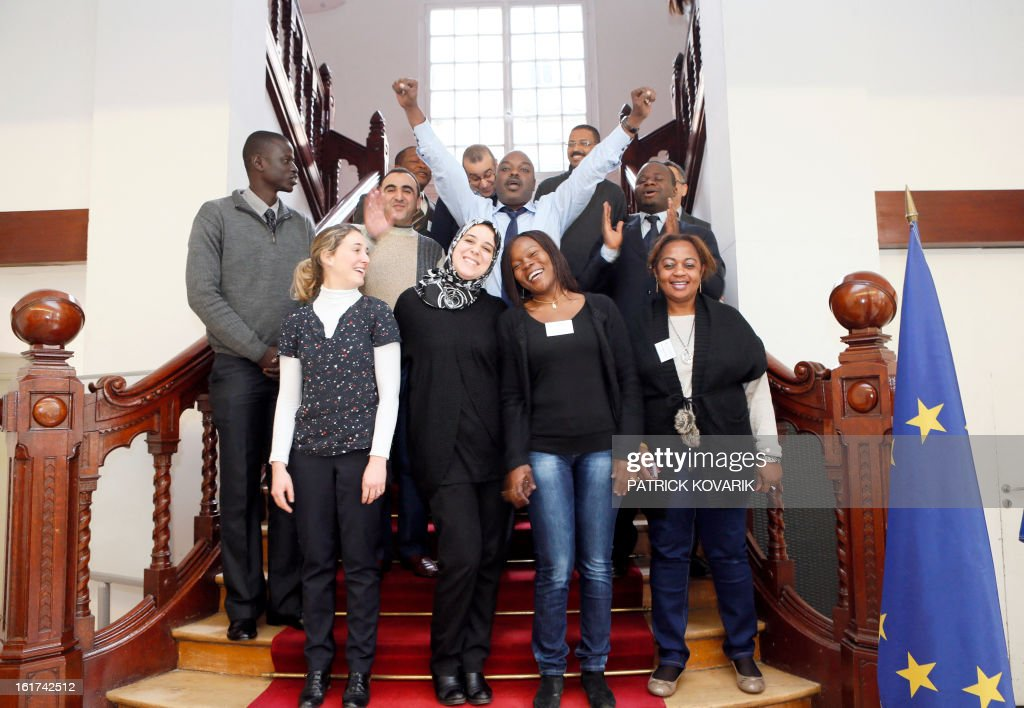 Students from Cameroon, Comoros, Djibouti, France, Gabon, Lebanon, Morocco and Chad, pose after their human resources and public service management formation at the elite ENA public service school, on February 15, 2013 in Paris.