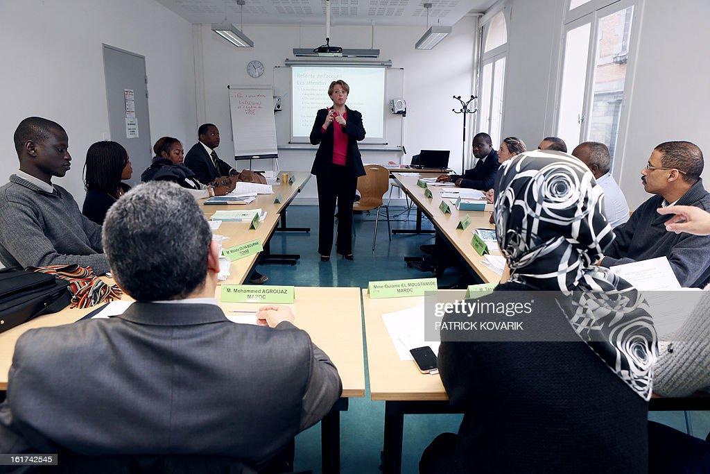Students from Cameroon, Comoros, Djibouti, France, Gabon, Lebanon, Morocco and Chad, take part in a human resources and public service management formation at the elite ENA public service school, on February 15, 2013 in Paris. AFP PHOTO PATRICK KOVARIK