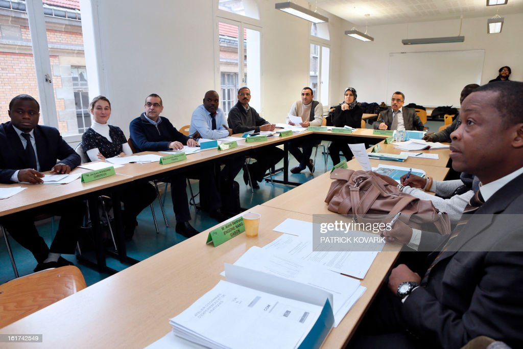 Students from Cameroon, Comoros, Djibouti, France, Gabon, Lebanon, Morocco and Chad, take part in a human resources and public service management formation at the elite ENA public service school, on February 15, 2013 in Paris.