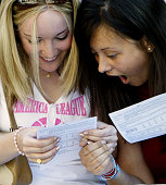 Students from Cardinal Vaughan Memorial School compare results as they receive their Alevel marks August 14 2003 in London England The results...