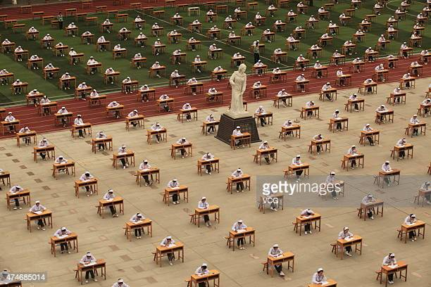 Students from College of Nursing in a vocational school take part in graduation examination outside classroom on May 25 2015 in Baoji Shaanxi...