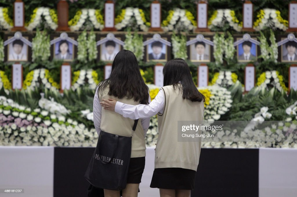 Students from Danwon high school pay tribute at a group memorial altar for victims of sunken passengers ship at the Ansan Olympic Memorial Hall on April 23, 2014 in Ansan, South Korea. At the altar, Friends and relatives are able to pay tribute to those who have passed in the April 16 ferry disaster off of Jindo Island in South Korea. The confirmed death toll now reached 130, and more than 170 people are still missing, as reported.