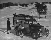 Students from Dartmouth College load ski equipment onto a station wagon owned by the Dartmouth Outing Club New Hampshire USA circa 1940