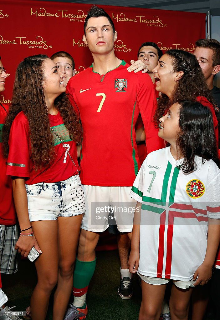 Students from Escola Lusitania - Portuguese School of the Portuguese Club of Long Branch pose with a Madame Tussauds wax figure of soccer player <a gi-track='captionPersonalityLinkClicked' href=/galleries/search?phrase=Cristiano+Ronaldo+-+Soccer+Player&family=editorial&specificpeople=162689 ng-click='$event.stopPropagation()'>Cristiano Ronaldo</a> as Madame Tussauds New York llaunches the <a gi-track='captionPersonalityLinkClicked' href=/galleries/search?phrase=Cristiano+Ronaldo+-+Soccer+Player&family=editorial&specificpeople=162689 ng-click='$event.stopPropagation()'>Cristiano Ronaldo</a> wax figure on June 25, 2013 in New York City.