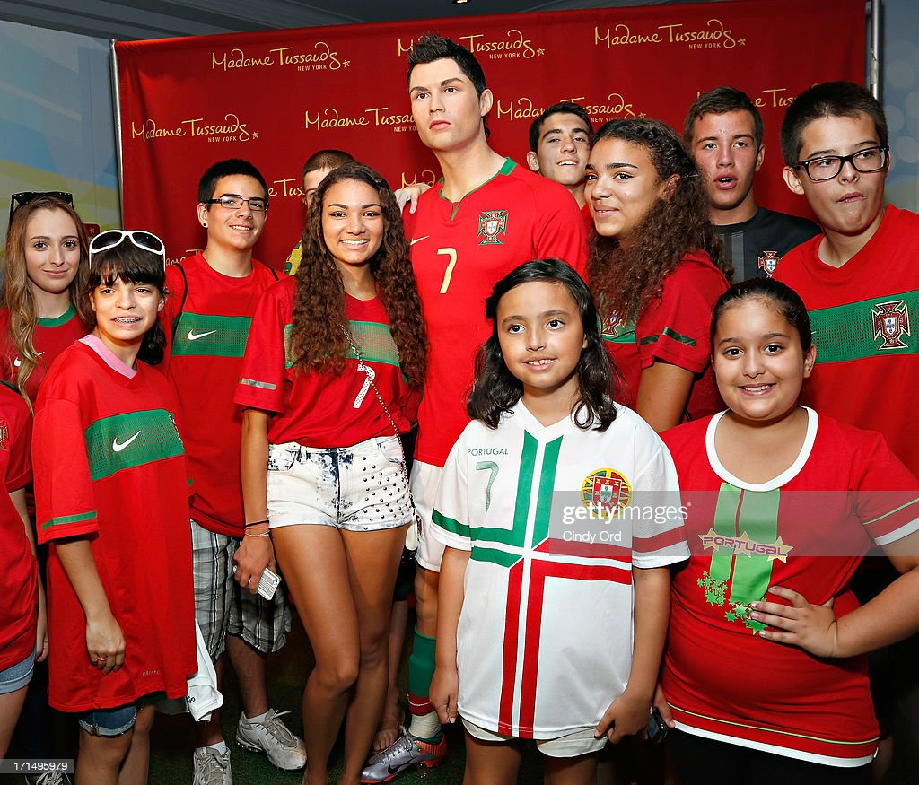 Students from Escola Lusitania - Portuguese School of the Portuguese Club of Long Branch pose with a Madame Tussauds wax figure of soccer player <a gi-track='captionPersonalityLinkClicked' href=/galleries/search?phrase=Cristiano+Ronaldo+-+Calciatore&family=editorial&specificpeople=162689 ng-click='$event.stopPropagation()'>Cristiano Ronaldo</a> as Madame Tussauds New York launches the <a gi-track='captionPersonalityLinkClicked' href=/galleries/search?phrase=Cristiano+Ronaldo+-+Calciatore&family=editorial&specificpeople=162689 ng-click='$event.stopPropagation()'>Cristiano Ronaldo</a> wax figure on June 25, 2013 in New York City.