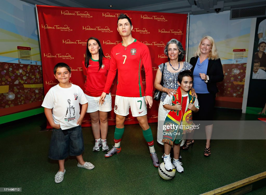 Students from Escola Lusitania - Portuguese School of the Portuguese Club of Long Branch (L and 2nd R), teacher Raquel Rosa (2nd R), Consul General of Portugal, Dr. Maria Amelia Paiva (3rd R) and Director of Marketing at Madame Tussauds NY Stacy MacGregor attend as Madame Tussauds New York launches the Cristiano Ronaldo (C) wax figure on June 25, 2013 in New York City.