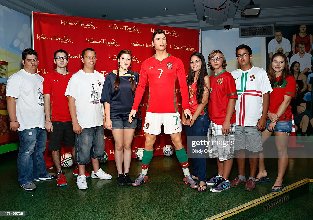 Students from Escola Lusitania - Portuguese School of the Portuguese Club of Long Branch attend as Madame Tussauds New York launches the <a gi-track='captionPersonalityLinkClicked' href=/galleries/search?phrase=Cristiano+Ronaldo+-+Calciatore&family=editorial&specificpeople=162689 ng-click='$event.stopPropagation()'>Cristiano Ronaldo</a> (C) wax figure on June 25, 2013 in New York City.