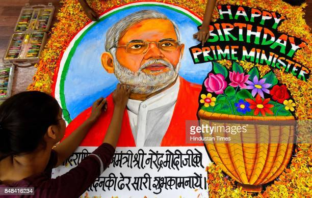 Students from Gurukul School of Art draw a painting of PM Narendra Modi to wish him on the occasion of his birthday at Lalbaug on September 16 2017...