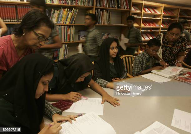 Students from Jafri English High School Govandi play Quiz Hunt Game after they receive certificate for English Access Microscholarship program...