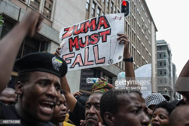 Students from Johannesburg and Witts universities hold placards reading 'Zuma must fall' as they arrive at the African National Congress ruling party...