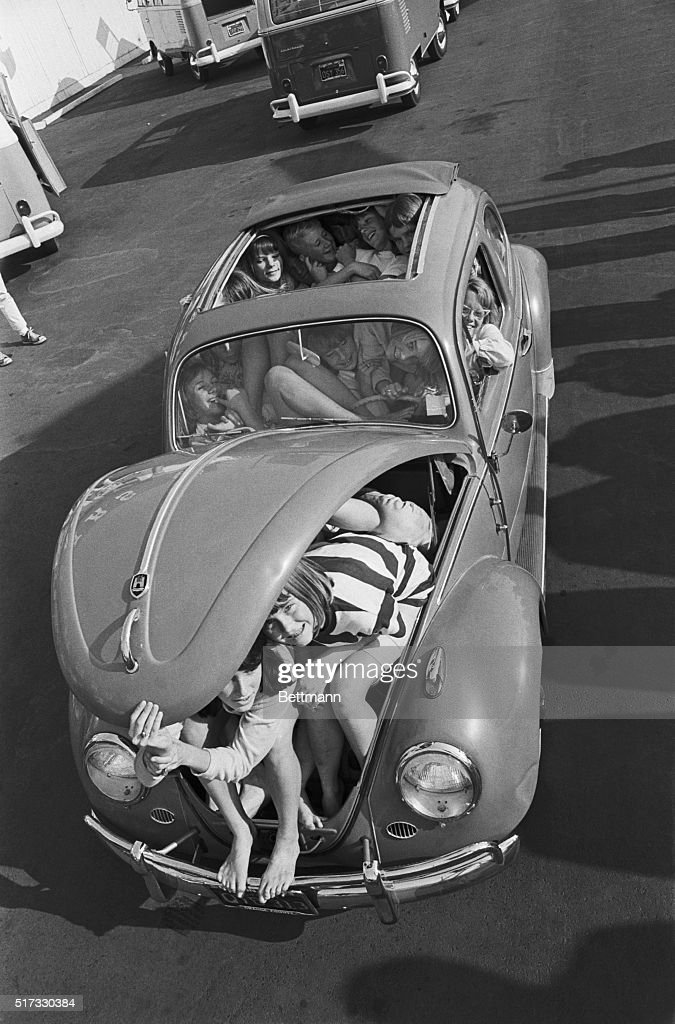 Students from Ladera Vista Junior High in Fullerton California cram themselves into a Volkswagen Beetle Ten boys and 21 girls fit in the car breaking...