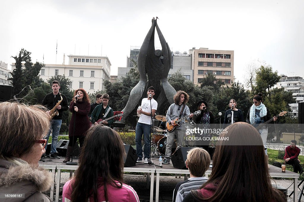 Students from music schools perform during a protest of Greek teachers and students on March 2, 2013 in Athens against cutbacks in the public education system due to the government's austerity measures. Demonstrators protested the lack of heat and food in many schools and the overall downgrade in public education. AFP PHOTO / LOUISA GOULIAMAKI