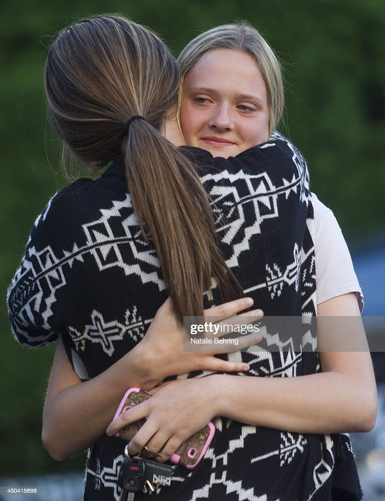 Students from Reynolds High School embrace as they meet at a church for a vigil to pray for the victims of today's school shooting June 10, 2014 in Gresham, Oregon. A gunman walked into an Oregon high school with a rifle and shot a student to death on Tuesday, in what is the the third outbreak of gun violence in a U.S. school in less than three weeks.