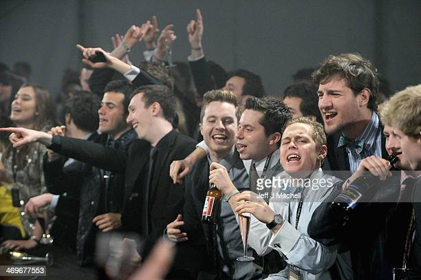 Students from St Andrews University enjoy themselves as they attend the 22nd annual charity fashion show on February 15 2014 in St Andrews Scotland...