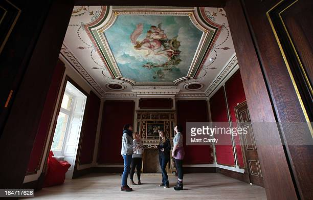 Students from Swansea Metropolitan University Rosie Cook Gemma Jessop Emily Cryer and Nicolle Evans look up to a fresco by artist Thomas WallaceHay...