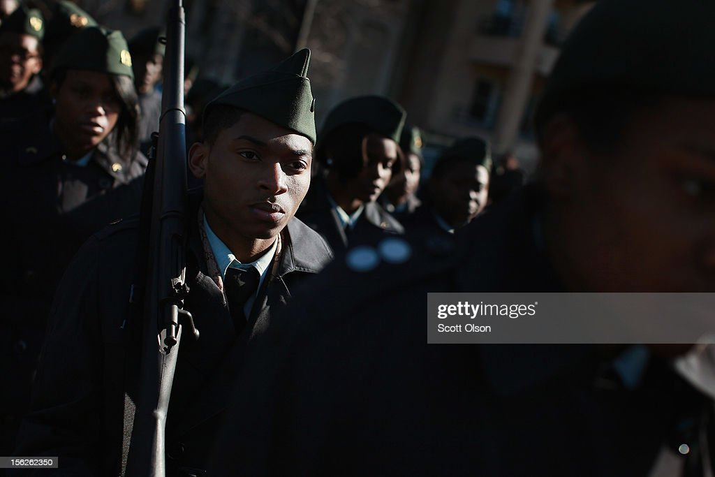 students from TEAM Englewood Community Academy participate in the Chicago Veterans Day parade on November 12, 2012 in Chicago, Illinois. Veterans Day, held the anniversary of the signing of the armistice which ended the World War I, is celebrated to honor all veterans for their service.