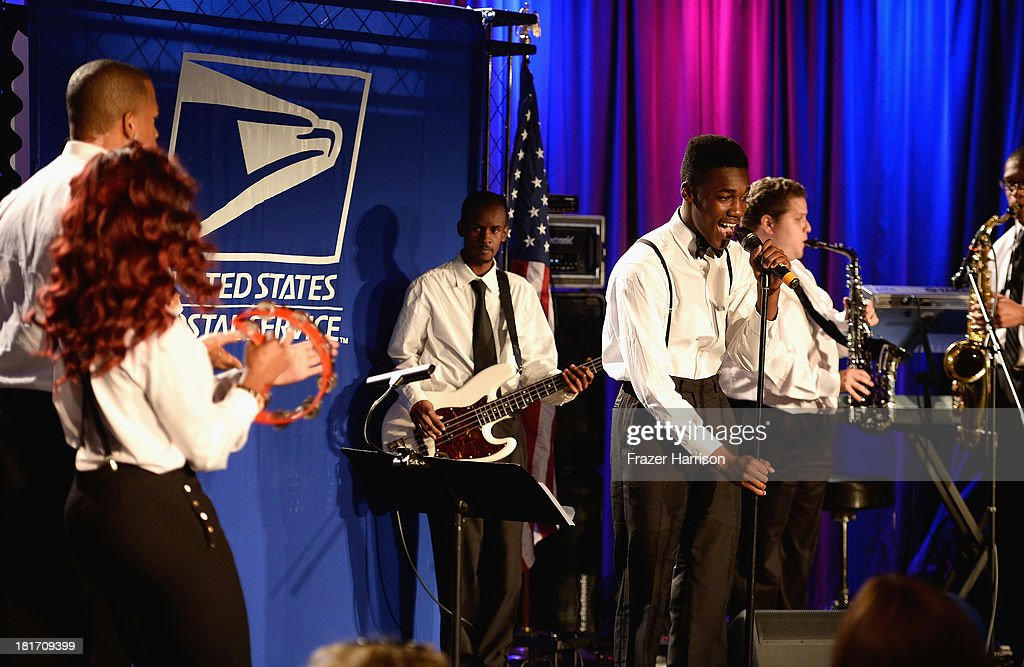 Students from the GRAMMY Museum Summer Sessions perform at the unveiling of the new Ray Charles stamp at the GRAMMY Museum in Los Angeles, Calif, on Monday, September 23, 2013. The limited-edition stamp is part of the Music Icons stamp series and is available for sale starting today, on what would have been his 83rd birthday, at post offices nationwide