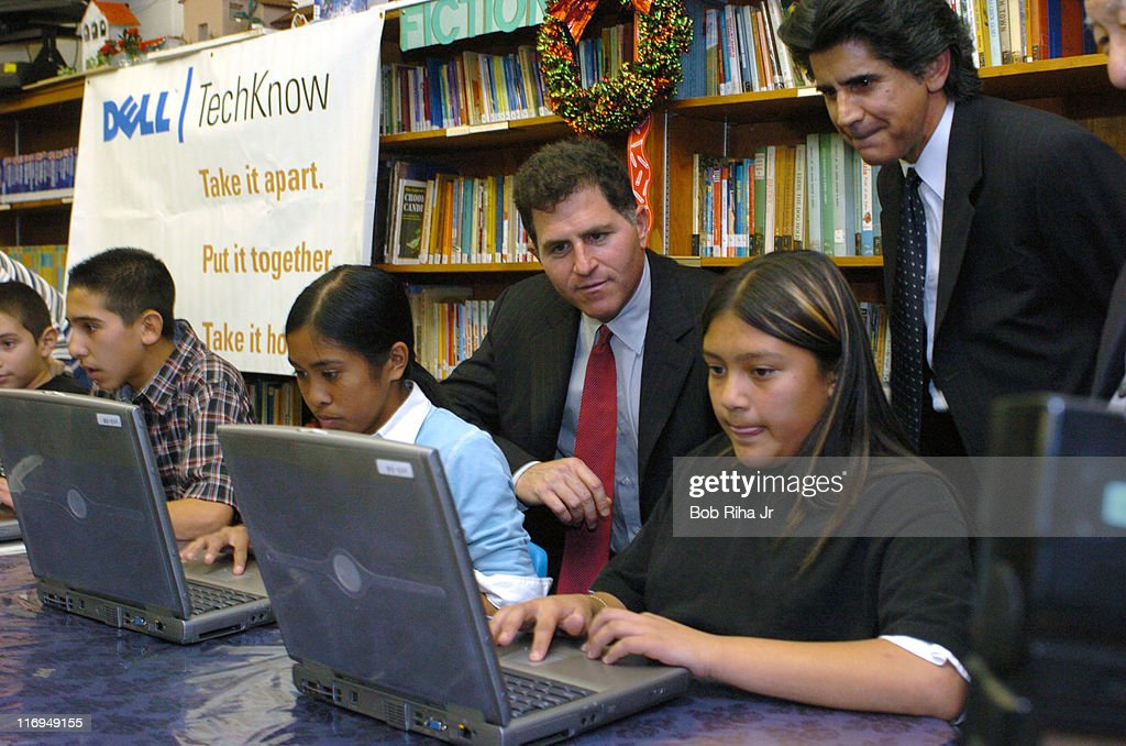 Students from the Hacienda La Puente Unified School District shows Michael Dell chairman of Dell Inc how to take apart and reassemble a computer...