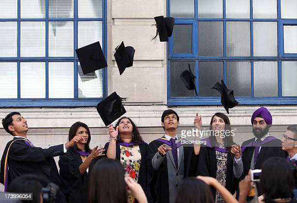 Students from the London School of Economics Political Science throw their mortar boards into the air in celebration during a ceremony for university...