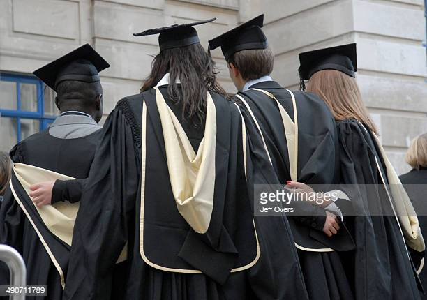 Students from the LSE on Graduation Day outside the college in central London Student university graduate graduating robe robes mortar board boards...
