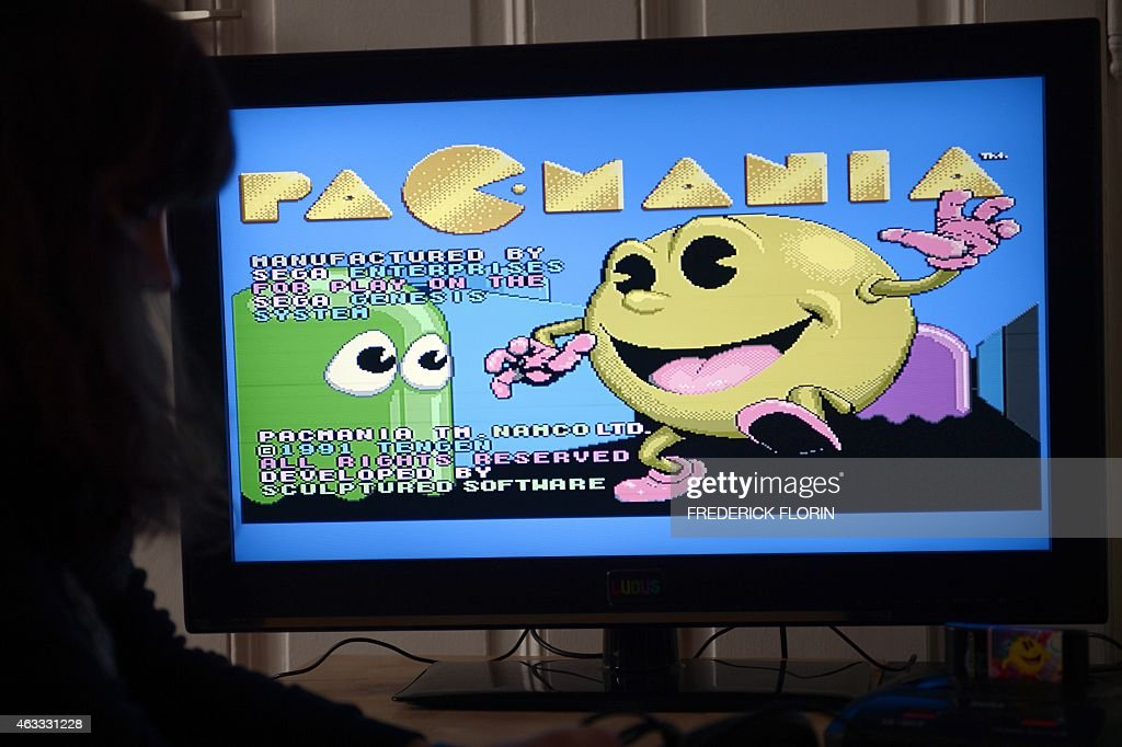 Students from the Ludus Academy play with the arcade video game PacMan in Strasbourg eastern France on February 12 2015 AFP PHOTO / FREDERICK FLORIN